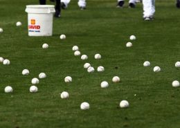 Feb 25, 2014; Maryvale, AZ, USA; Milwaukee Brewers prepare to pick up dozens of base balls used in Spring Training practice at Maryvale Baseball Park. Mandatory Credit: Lance Iversen-USA TODAY Sports